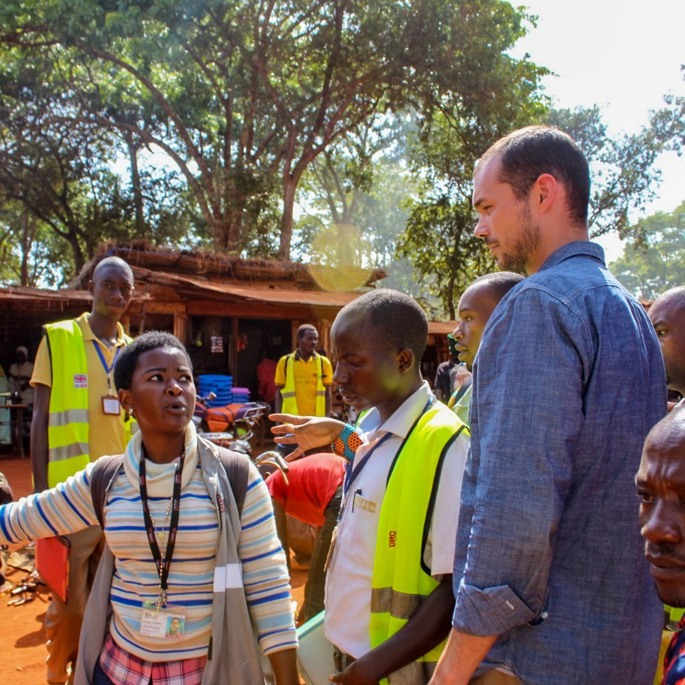 SIT student talking with humanitarian workers