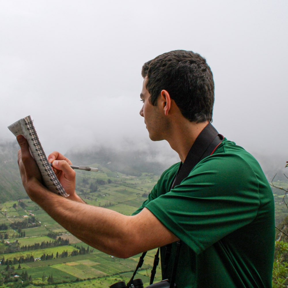 SIT student taking notes in the field in Ecuador