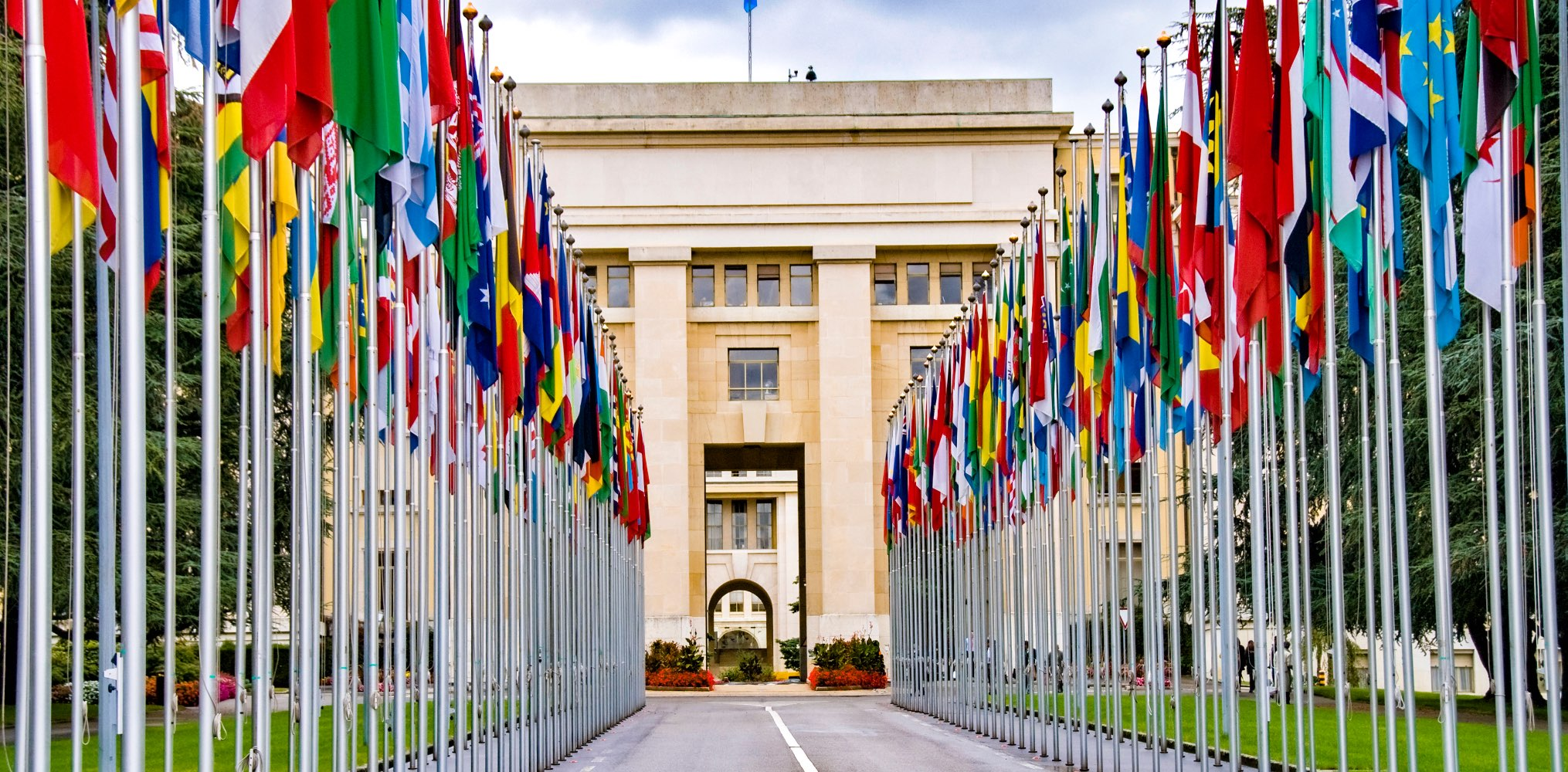 The entrance to the United Nations in Geneva, Switzerland lined with flags from various countries